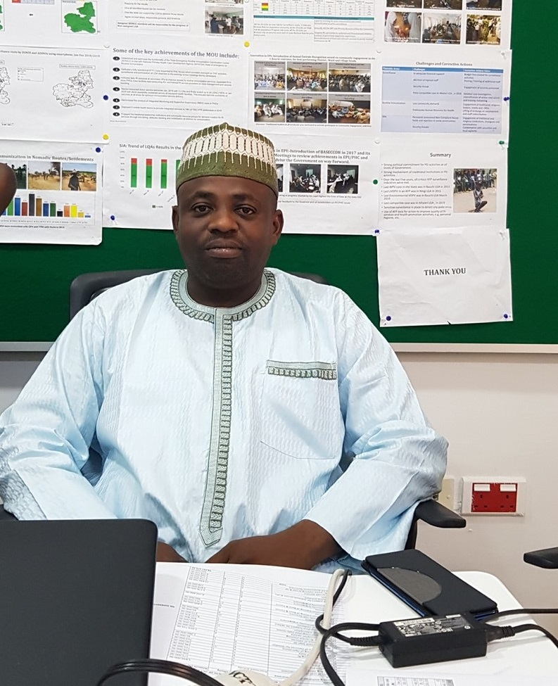 Chief Administration Officer, Ibrahim Ahmed, sitting at a desk